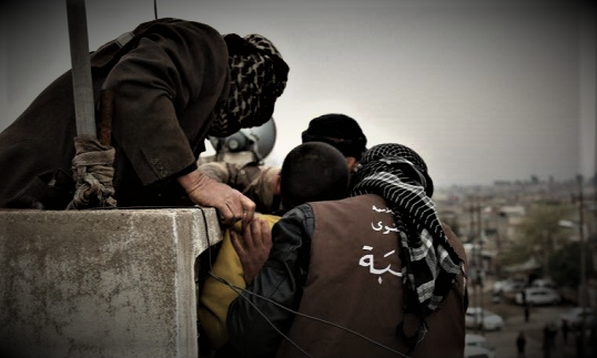 EVIL - ISIS Members Throw Gay Man Off Building & Hit Him With Rocks